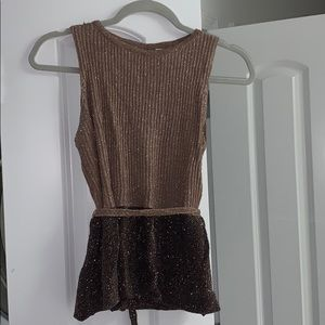 Shimmery sleeveless top.